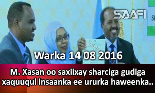 Photo of Warka 14 08 2016 M. Xasan oo saxiixay sharciga xaquuqul insaanka ee ururka haweenka usoo..
