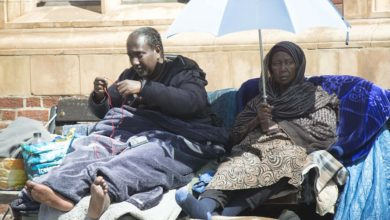 Photo of The Somali mother and son who have chosen to live on a high street bench for three years, despite council's repeated attempts to rehouse them (including in TWO flats they turned down)