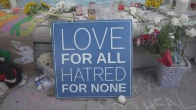Anti-Islam protester thrown into fountain at Danforth shooting memorial in Toronto