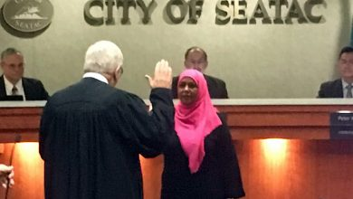 Photo of Amina Ahmed sworn in to Council; Dave's Diner recognized by city